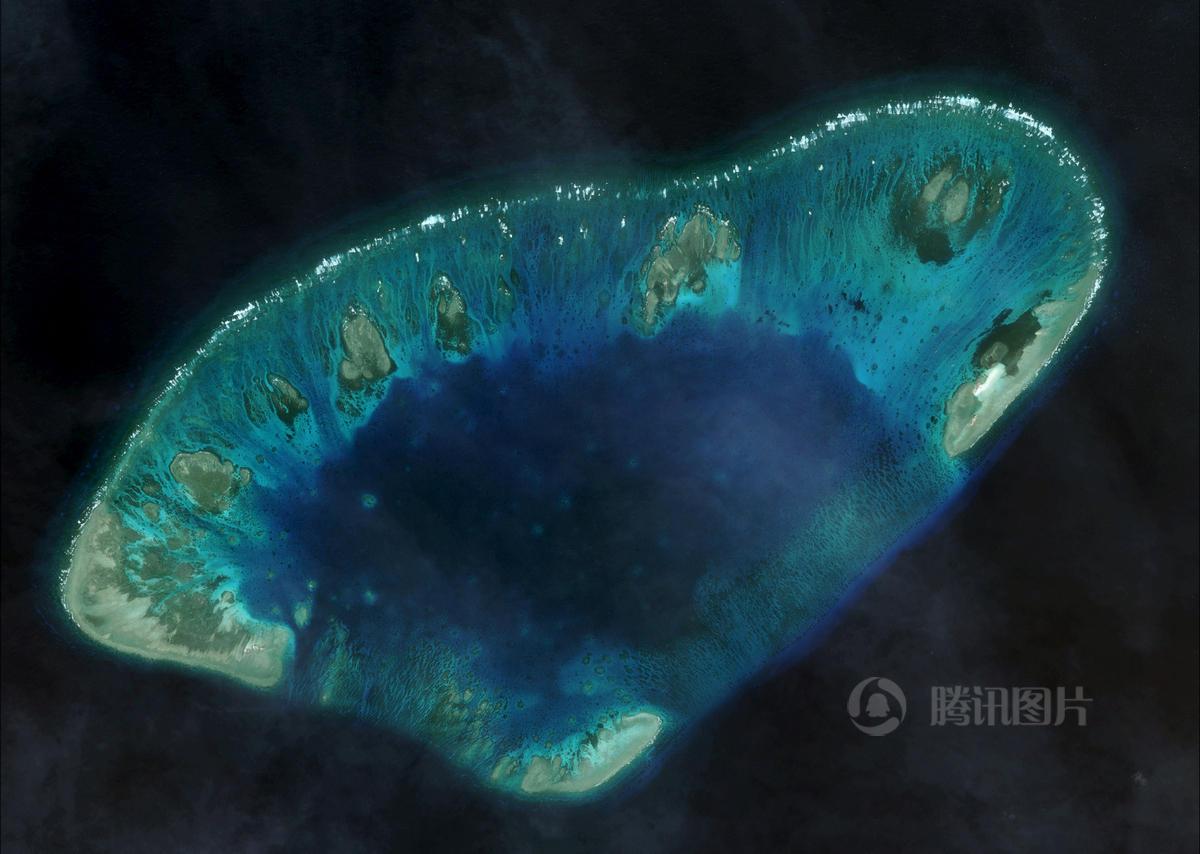 卫星照片显示越南扩建非法占据南沙岛礁